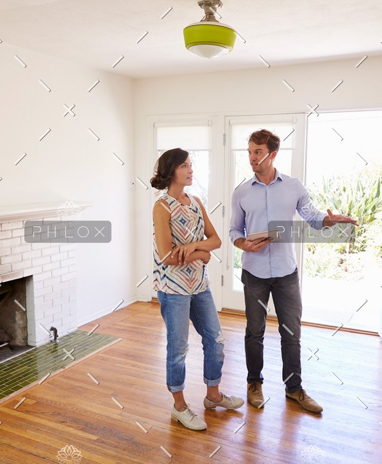 demo-attachment-41-male-realtor-showing-female-client-around-house-PXLCYLL-784x951