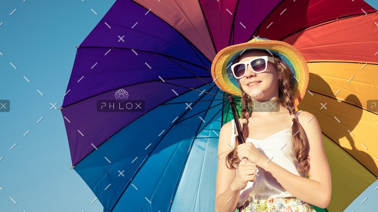 demo-attachment-35-teen-girl-with-umbrella-standing-on-the-beach-at-PMEQ6S8