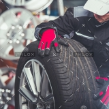 demo-attachment-241-replacing-car-tires-F6SZJYW