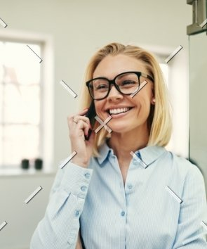 demo-attachment-57-businesswoman-smiling-and-talking-on-her-4C3HEDM